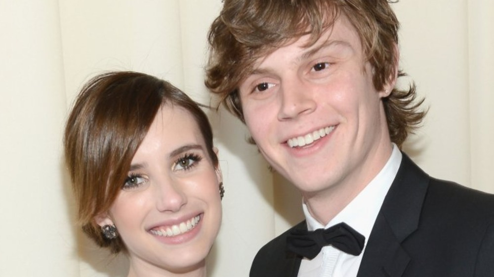 Emma Roberts and Evan Peters smiling