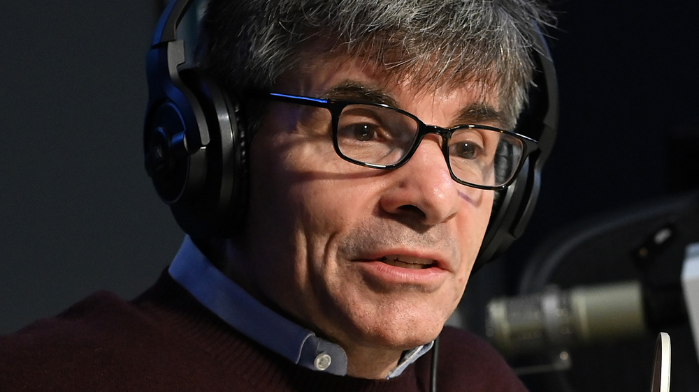 George Stephanopoulos sitting during an interview