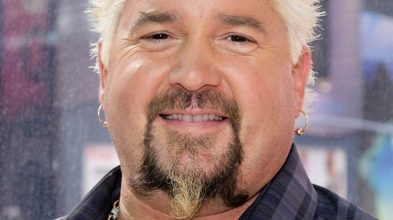Guy Fieri smiles at an event