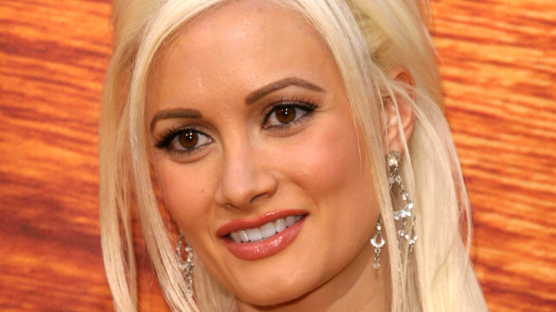 Holly Madison with chandelier earrings