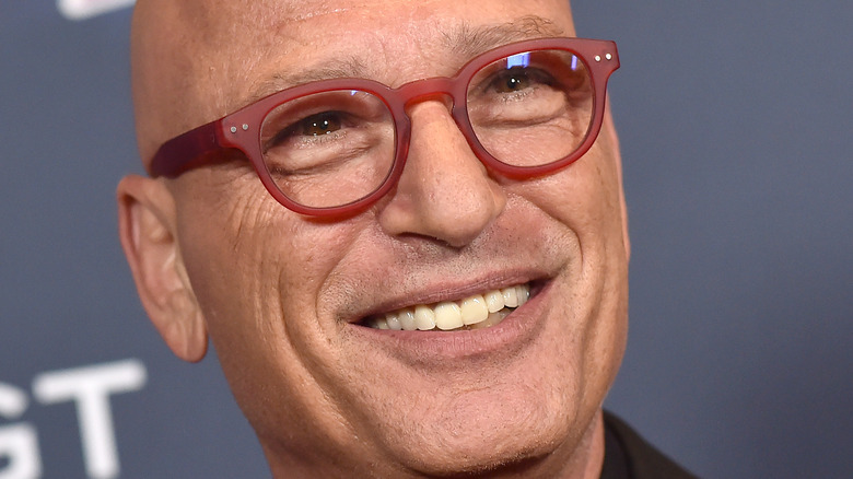 Howie Mandel smiles on the red carpet