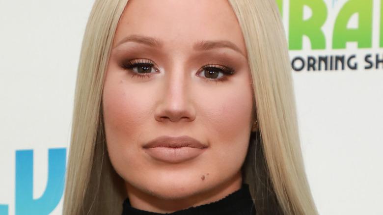 Iggy Azalea, not smiling, blond hair straight down, 2019 radio appearance