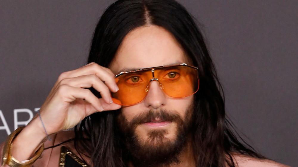 Jared Leto adjusts sunglasses