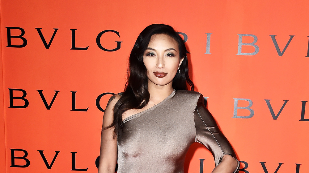 Jeannie Mai smiling on the red carpet
