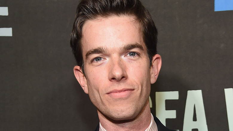 John Mulaney with a microphone
