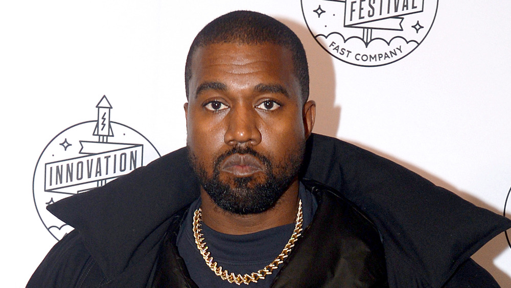Kanye West posing at a red carpet event
