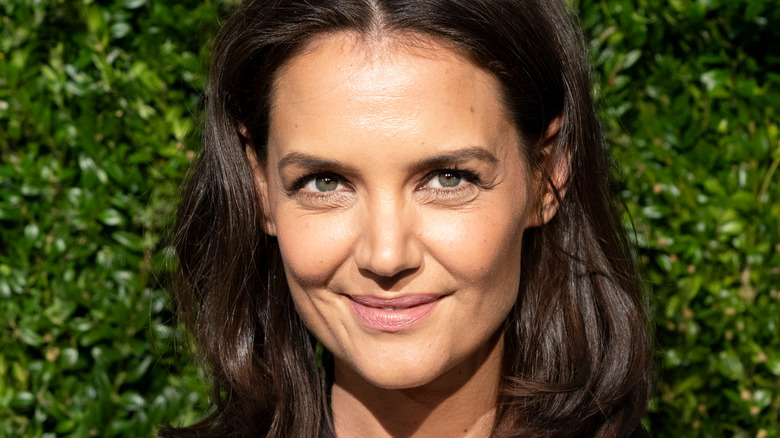 Katie Holmes smiling at a red carpet event