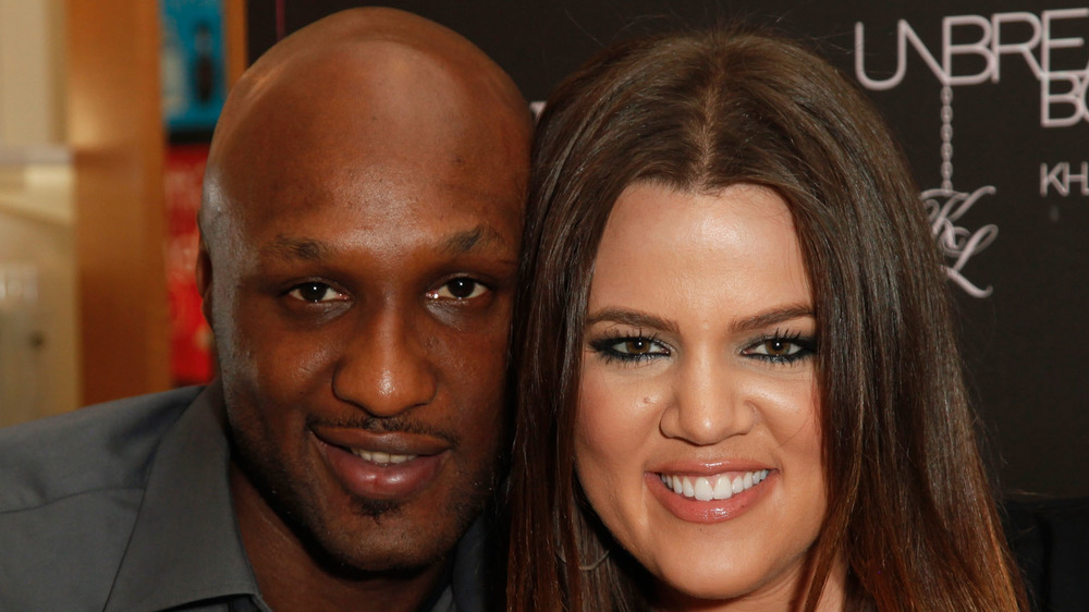 Khloe Kardashian and Lamar Odom pose for a picture