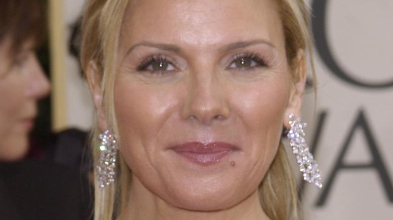 Kim Cattrall wearing diamond earrings