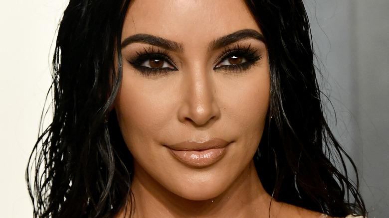 Kim Kardashian, 2020 Oscars party, half smiling, her black hair down, wearing makeup