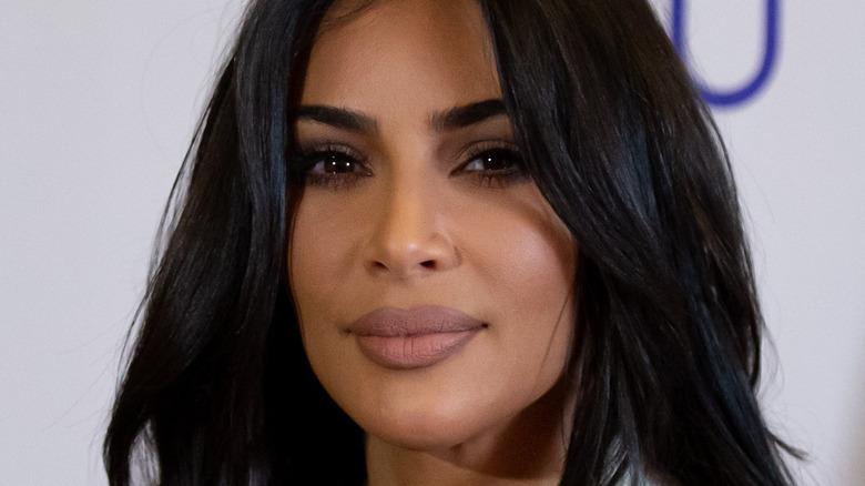 Kim Kardashian smiling slightly