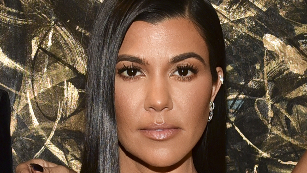 Kourtney Kardashian staring at camera