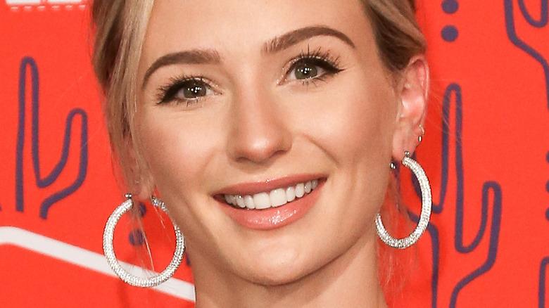 Lauren Bushnell smiling on red carpet