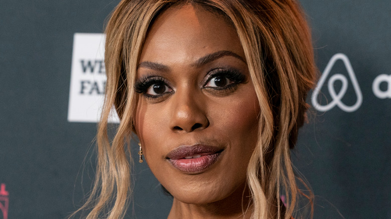Laverne Cox smiling at a red carpet event