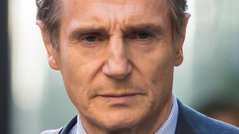 Liam Neeson staring