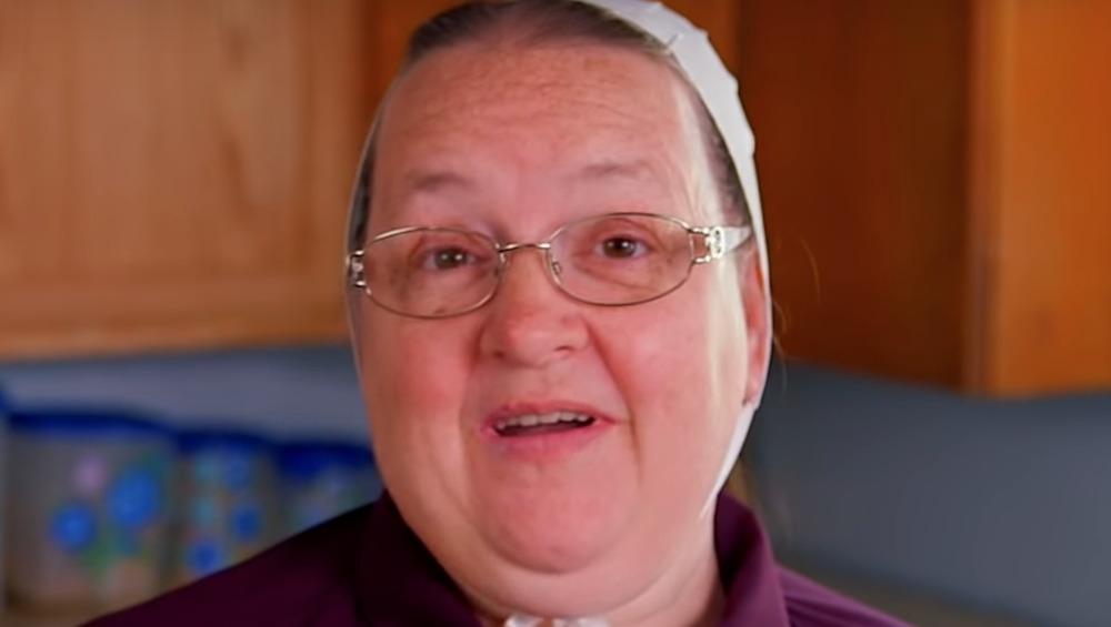 Mama Mary Schmucker speaks into a camera