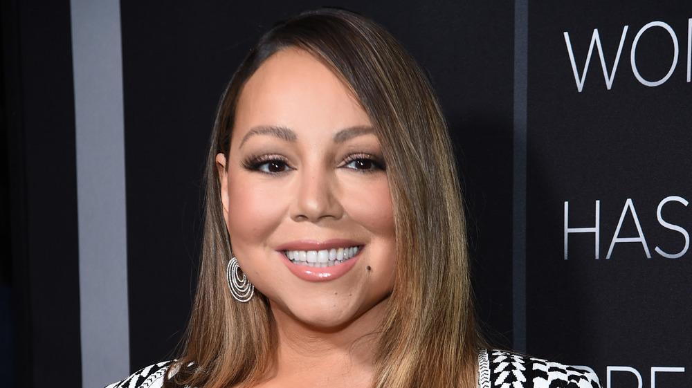 Mariah Carey smiling on the red carpet