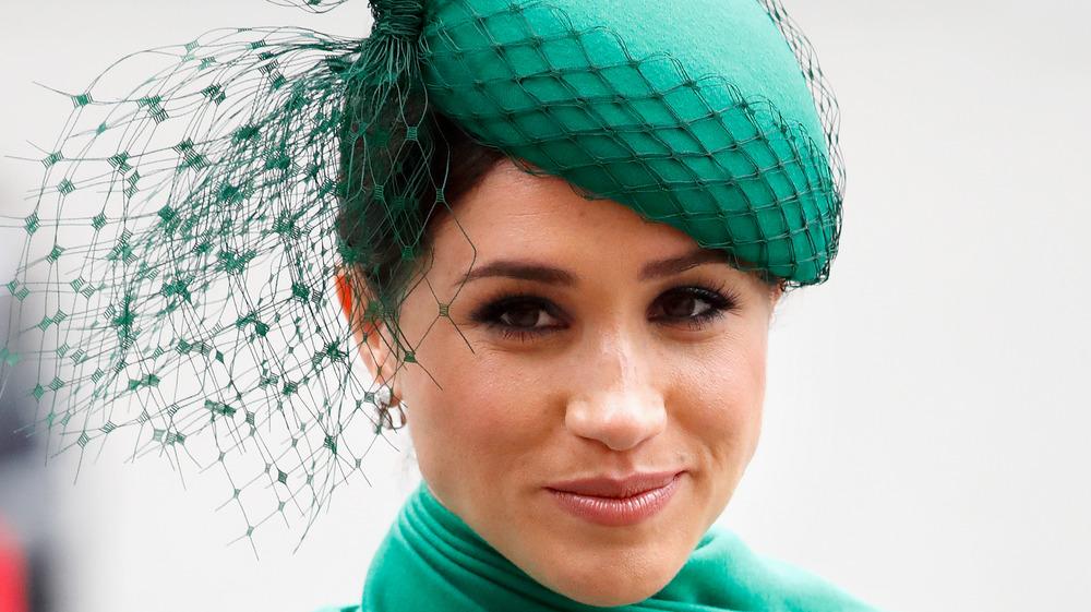 Meghan Markle wearing a green hat