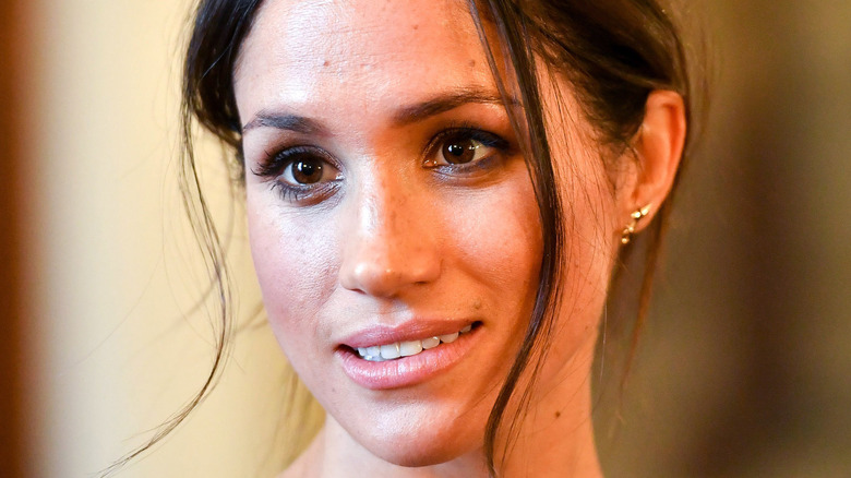 Meghan Markle with a serious expression