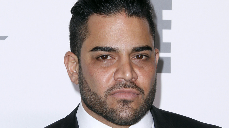 Mike Shouhed posing at a red carpet event
