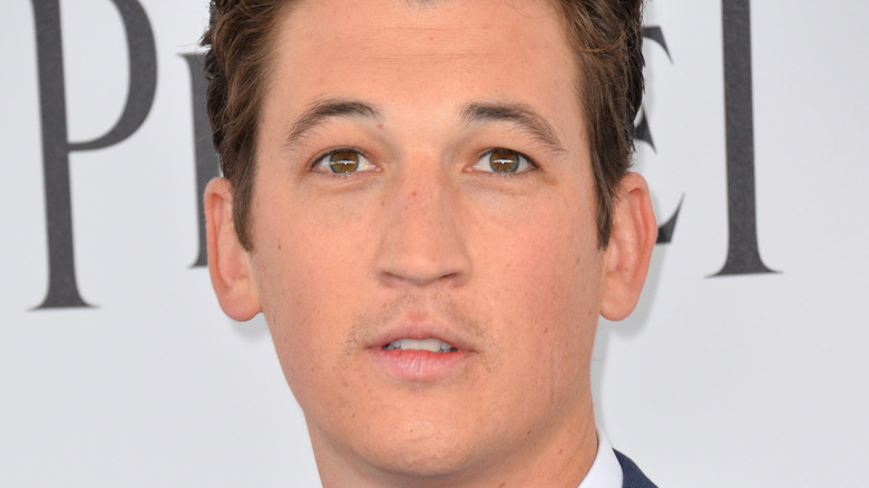 Miles Teller gives a perplexed look on the red carpet