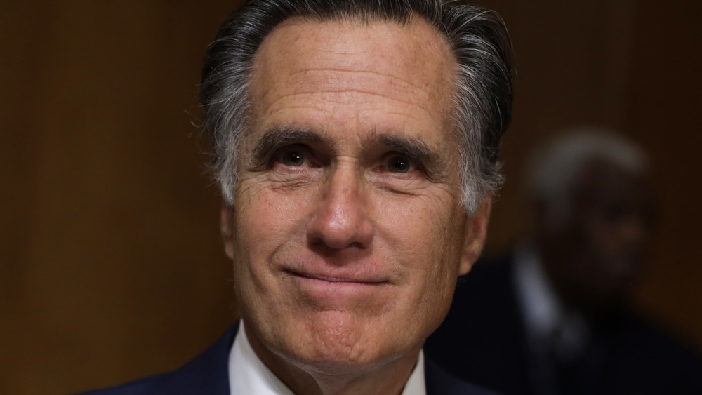 Mitt Romney smiling at an event