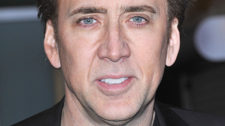 Nicolas Cage with slight smile at event