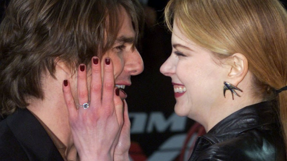 Nicole Kidman touching Tom Cruise's face