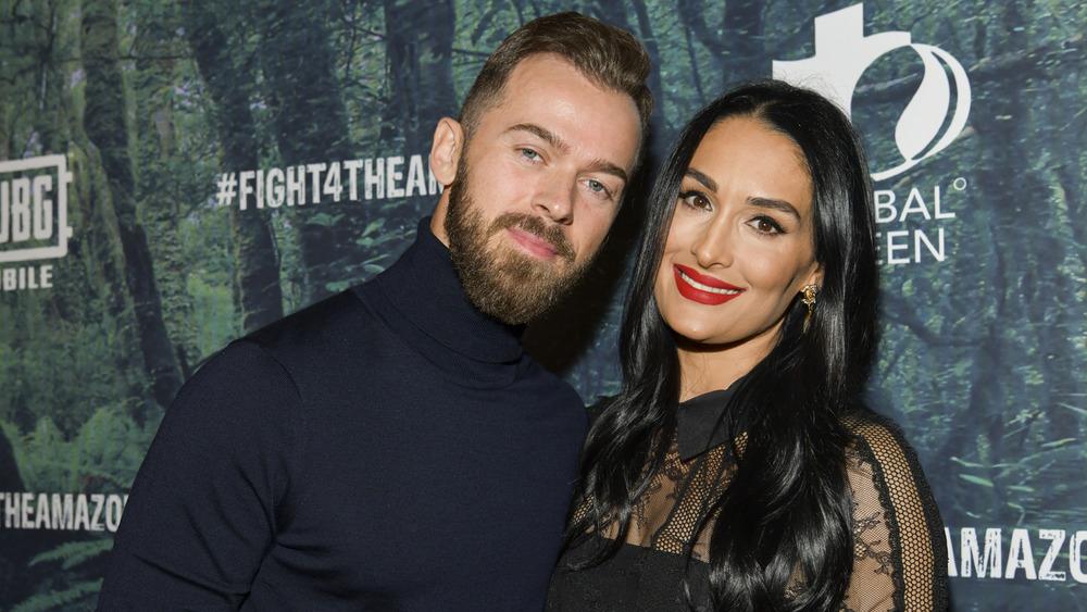 Artem Chigvinstev and Nikki Bella on a red carpet