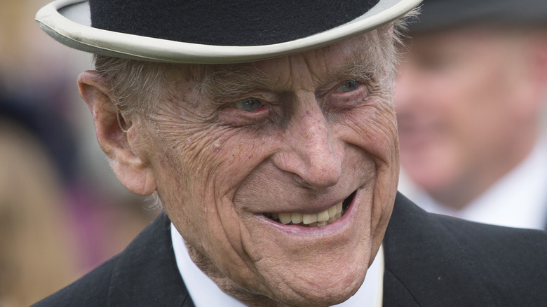 Prince Philip smiling in top hat