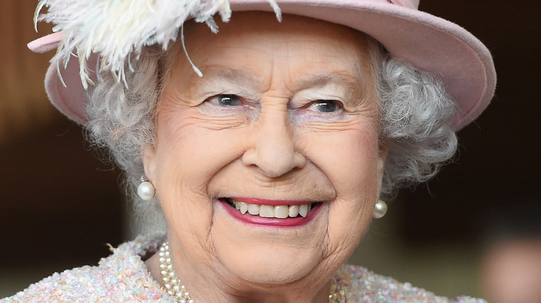 Queen Elizabeth smiles at an engagement