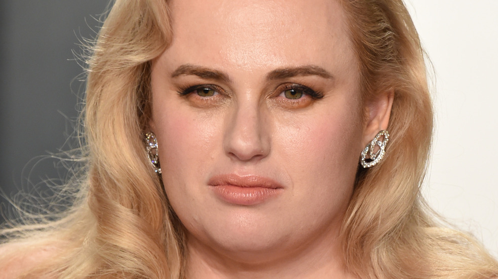 Rebel Wilson staring with a neutral expression