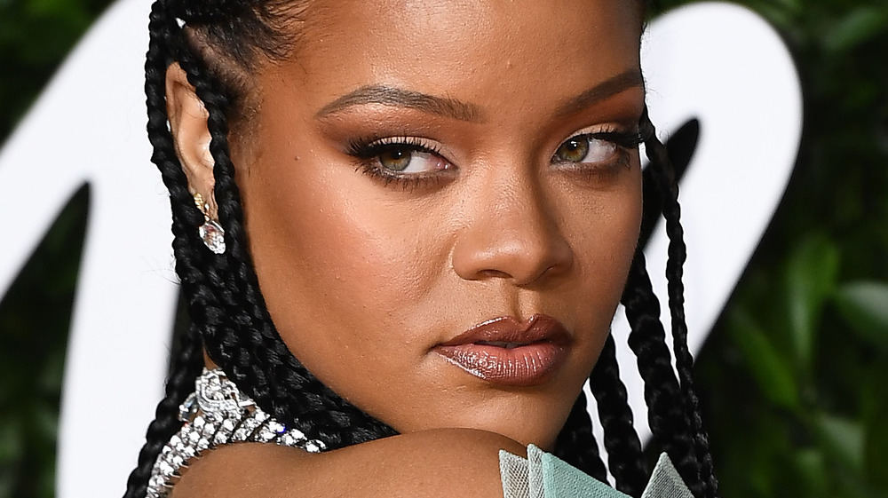 Rihanna posing in braids