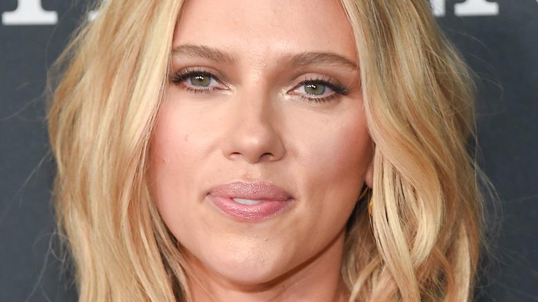 Scarlett Johansson smiles on red carpet