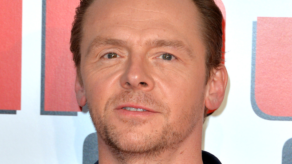 Simon Pegg with a serious expression