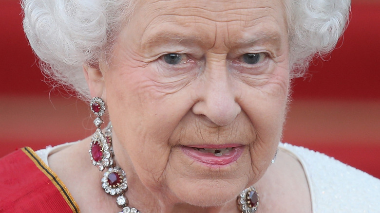 The queen with a neutral expression