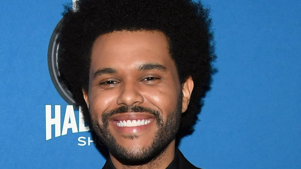 The Weeknd smiling at Super Bowl conference