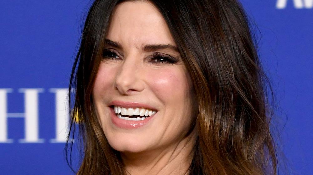 Sandra Bullock smiling on the Golden Globes red carpet