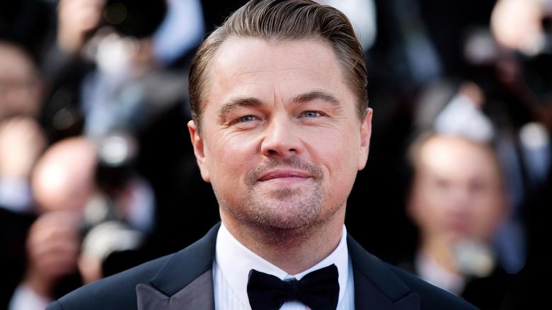 Leonardo DiCaprio in a suit, smiling