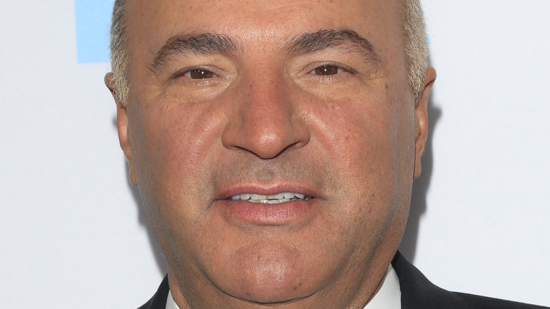 kevin o'leary smiling looking up