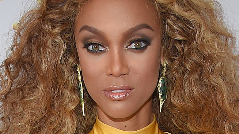 Tyra Banks looking at camera with slight smile