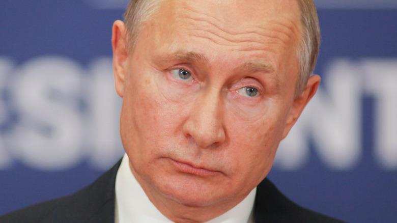 Vladimir Putin looking stoically on