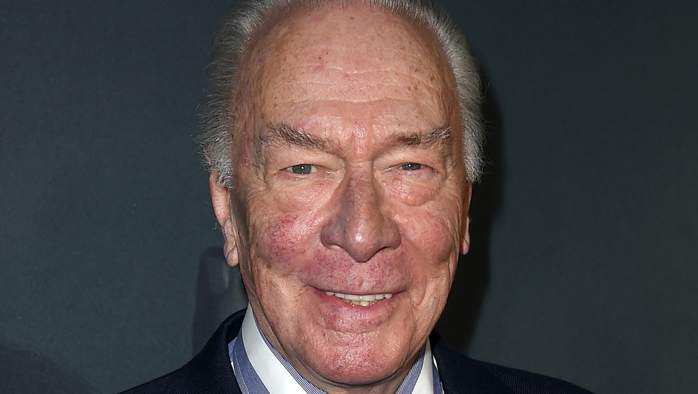 Christopher Plummer smiles for a photo at an event