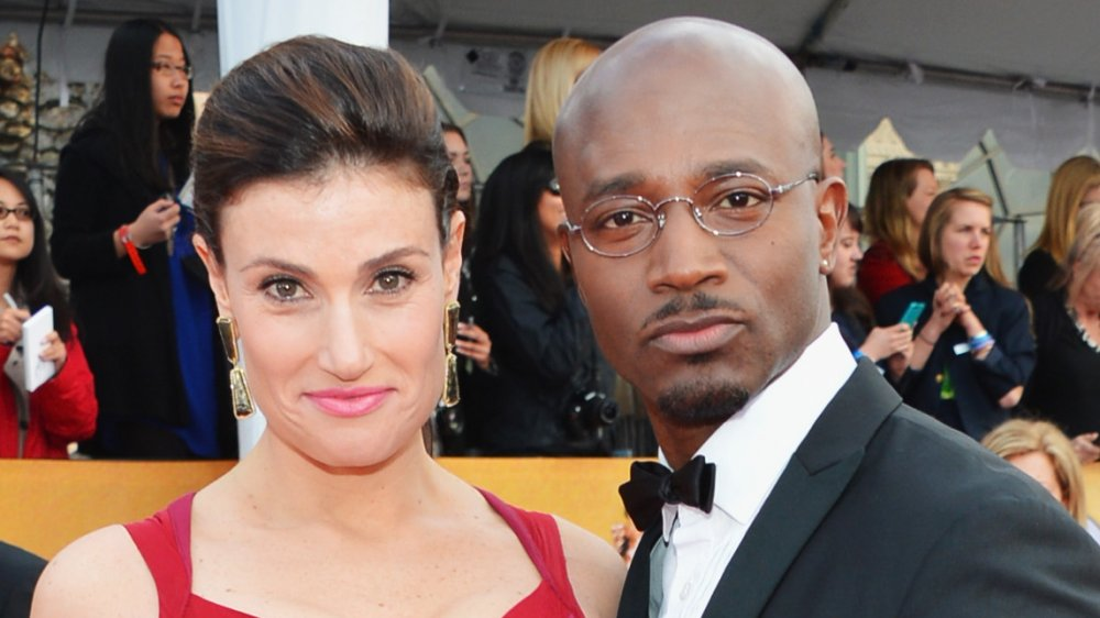 Idina Menzel and Taye Diggs on a red carpet