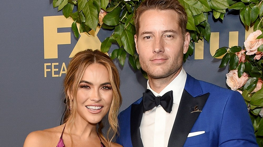 Chrishell Stause, Justin Hartley posing on the red carpet