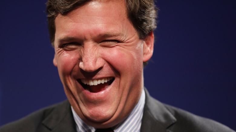 Tucker Carlson laughing