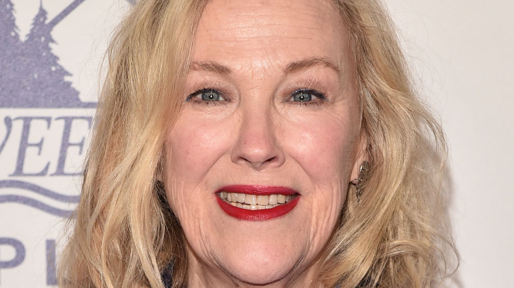 Catherine O'Hara smiling with red lipstick