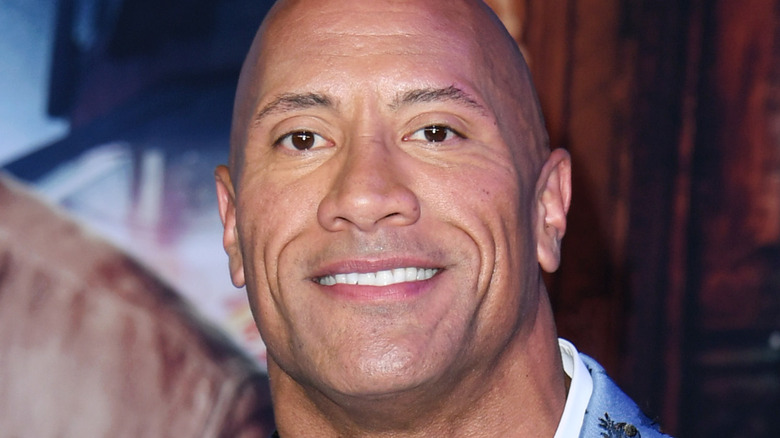 The Rock smiling red carpet