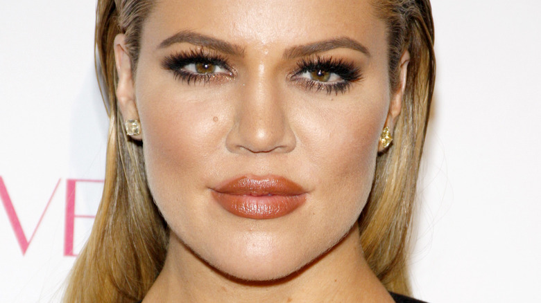 Khloé Kardashian smirking