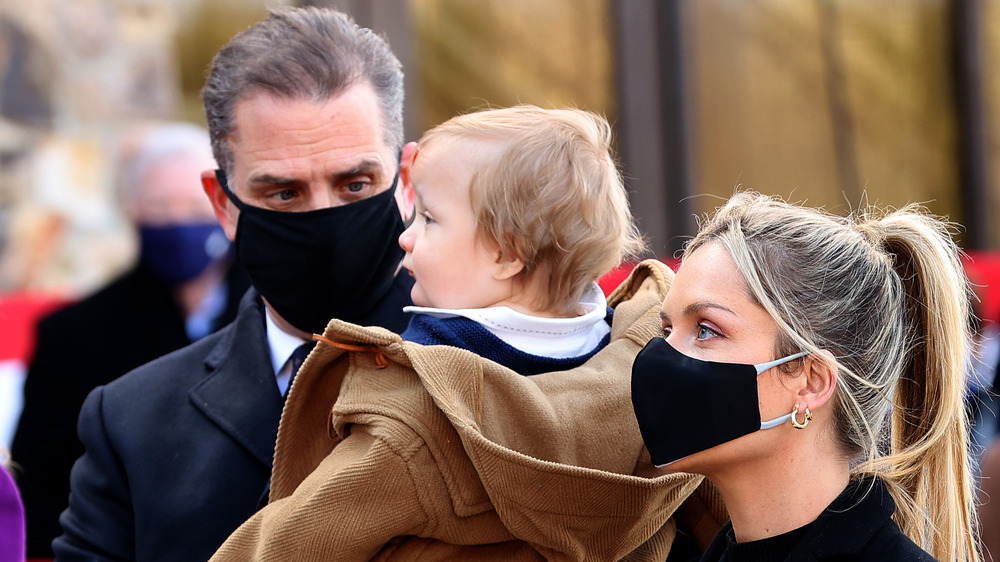 Hunter Biden holding his son Beau during the inauguration